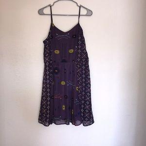 Purple dress with arrows on it